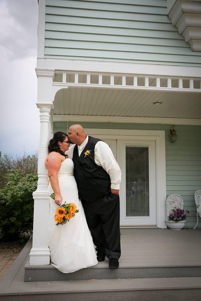 Groom kidding his bride's forehead in Billings, Montana wedding