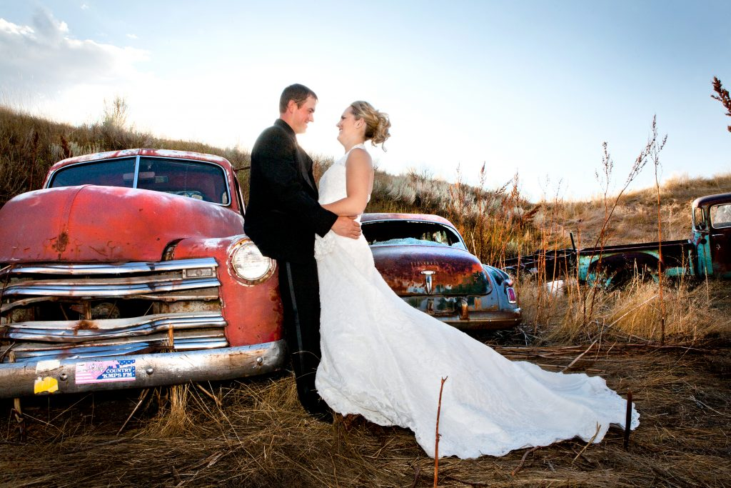 bride and groom with vintage cars