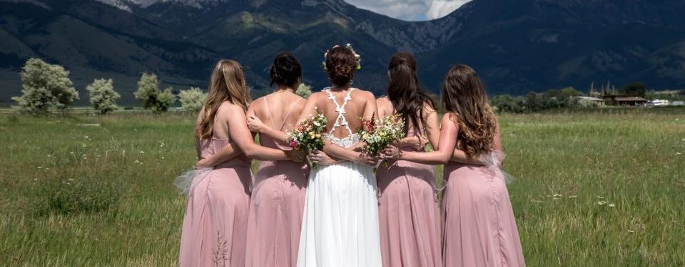 Bride and bridesmaids againt mountain
