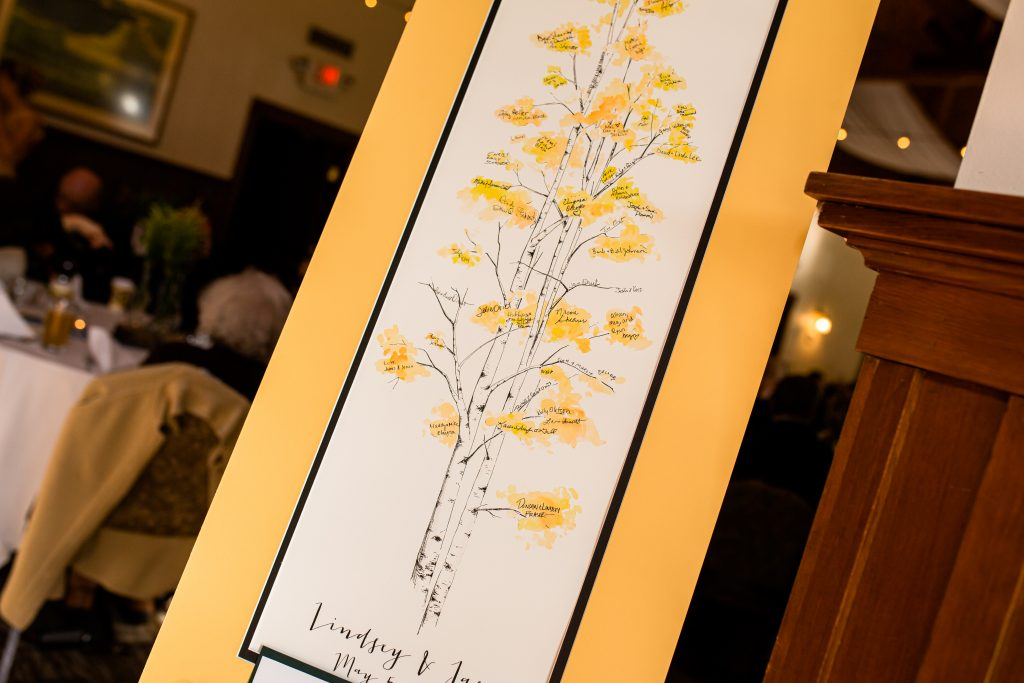 a yellow tree for guests to sign as the guest book