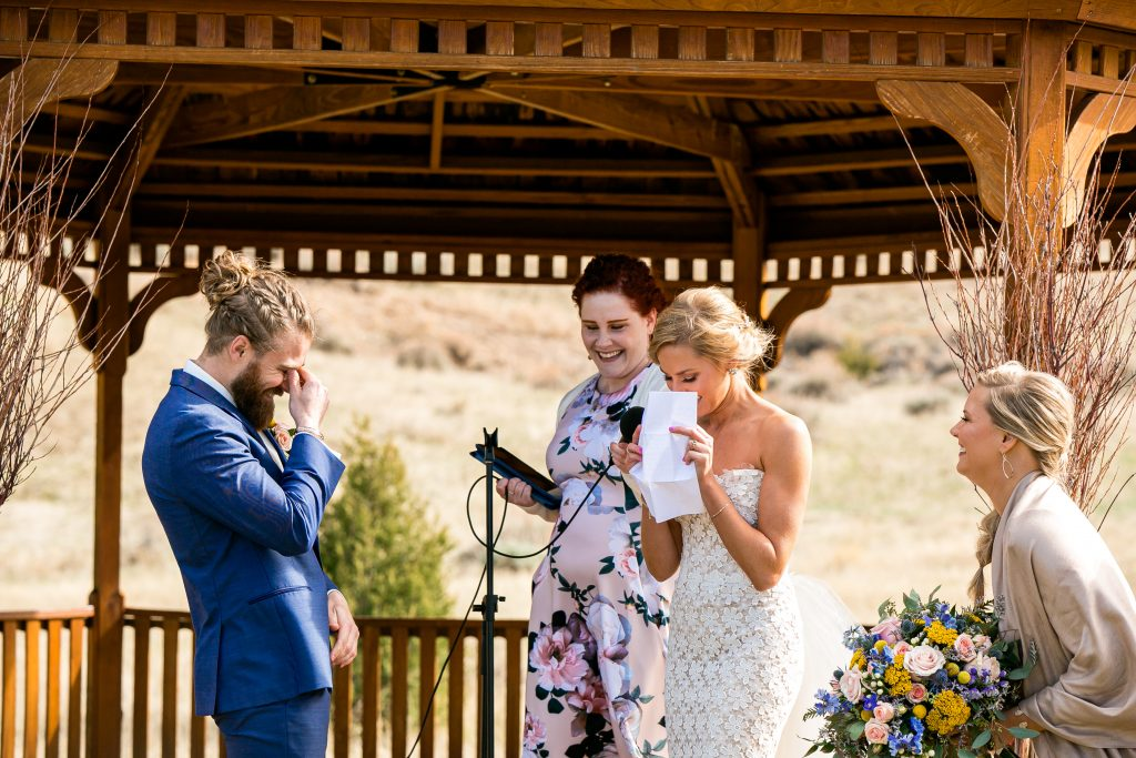 bride crying while reading her vows