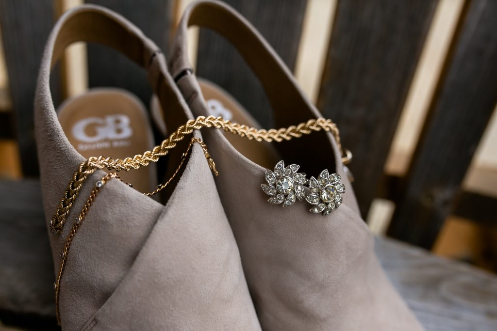 brides shoes with earrings and bracelet displayed on them
