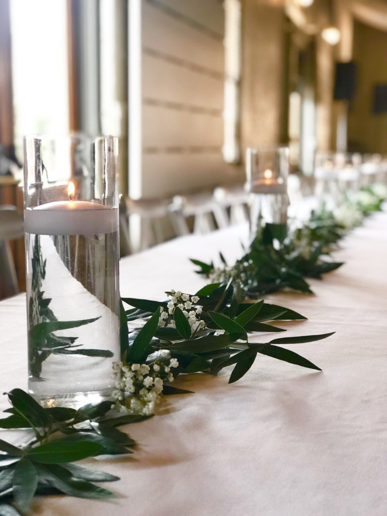 eucalyptus running down the length of the table with floating candles