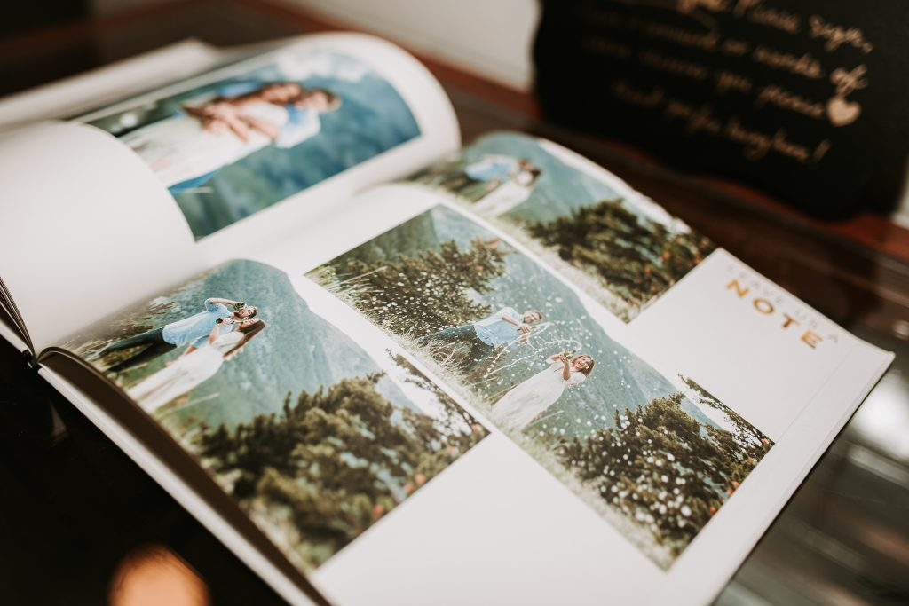 Wedding guestbook with engagement pictures of the couple
