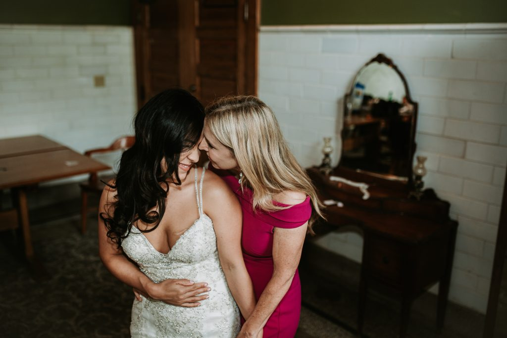 bride and her mom hugging