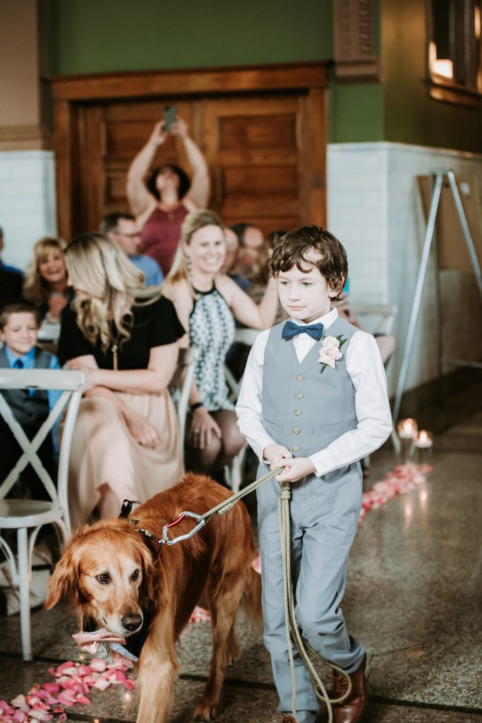ring bearer walking the couples dog down the aisle