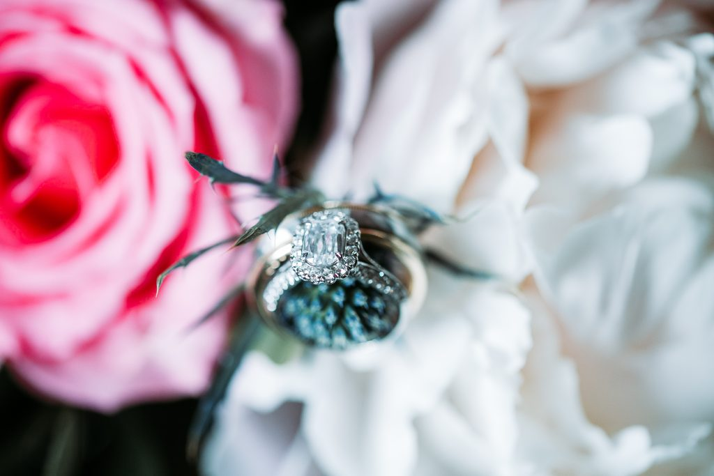 brides wedding ring on her bouquet