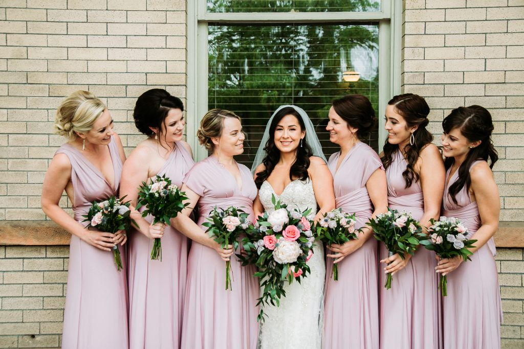 bride and bridesmaids standing outside of the Billings Depot