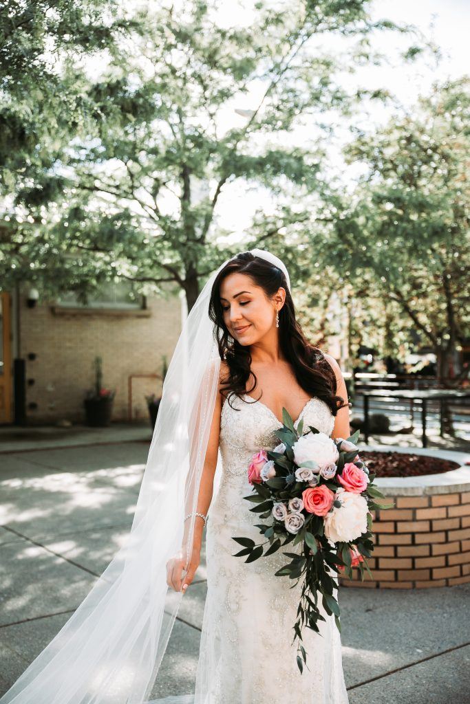 bride in her wedding dress holding flowers
