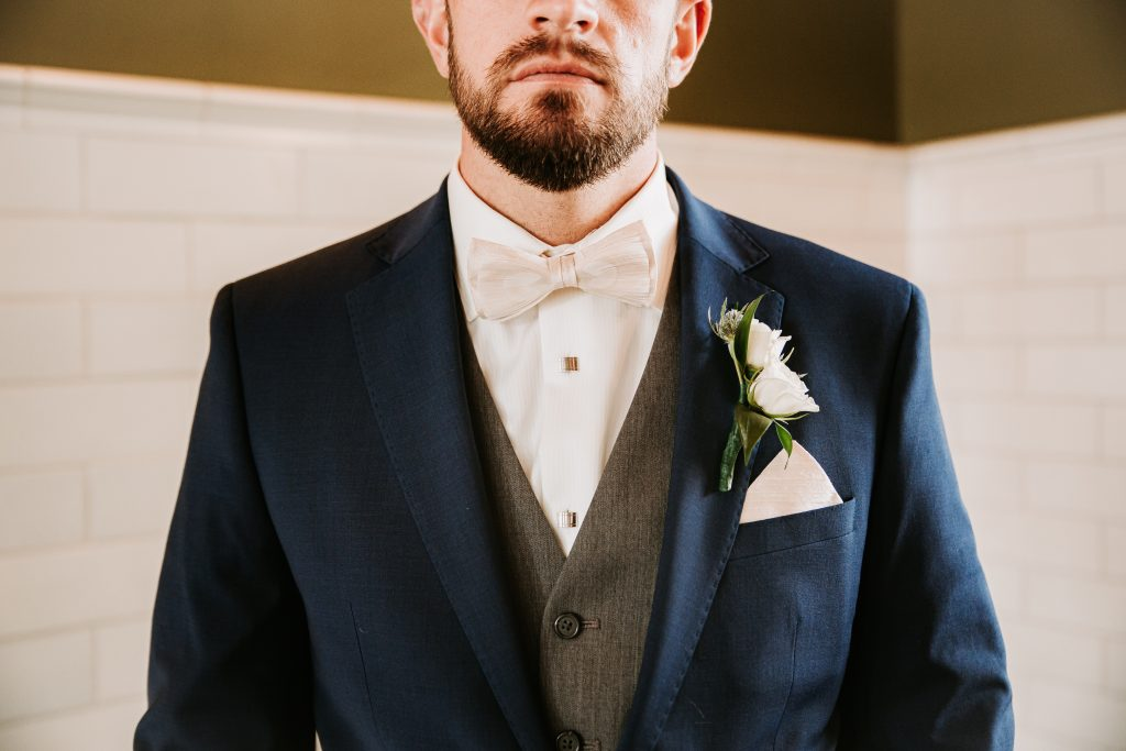 groom with his suite and jacket on