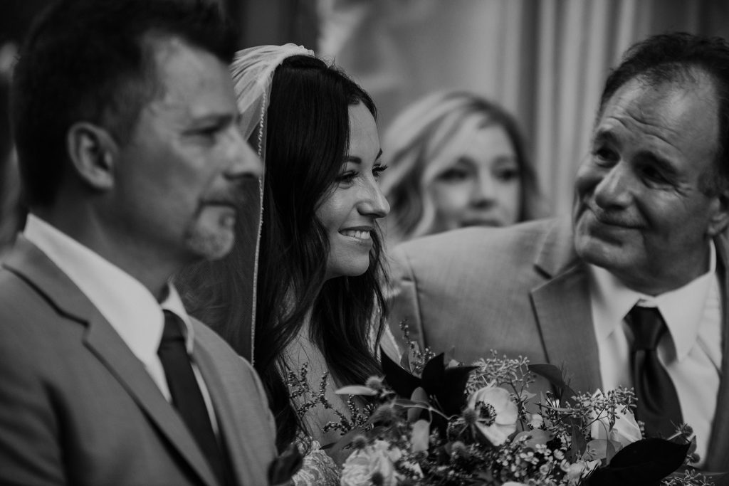 bride standing with her dad as he gives her away