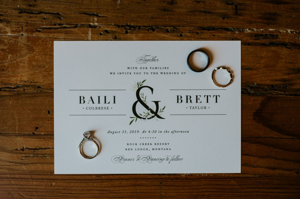 Wedding invitation with wedding rings on it
