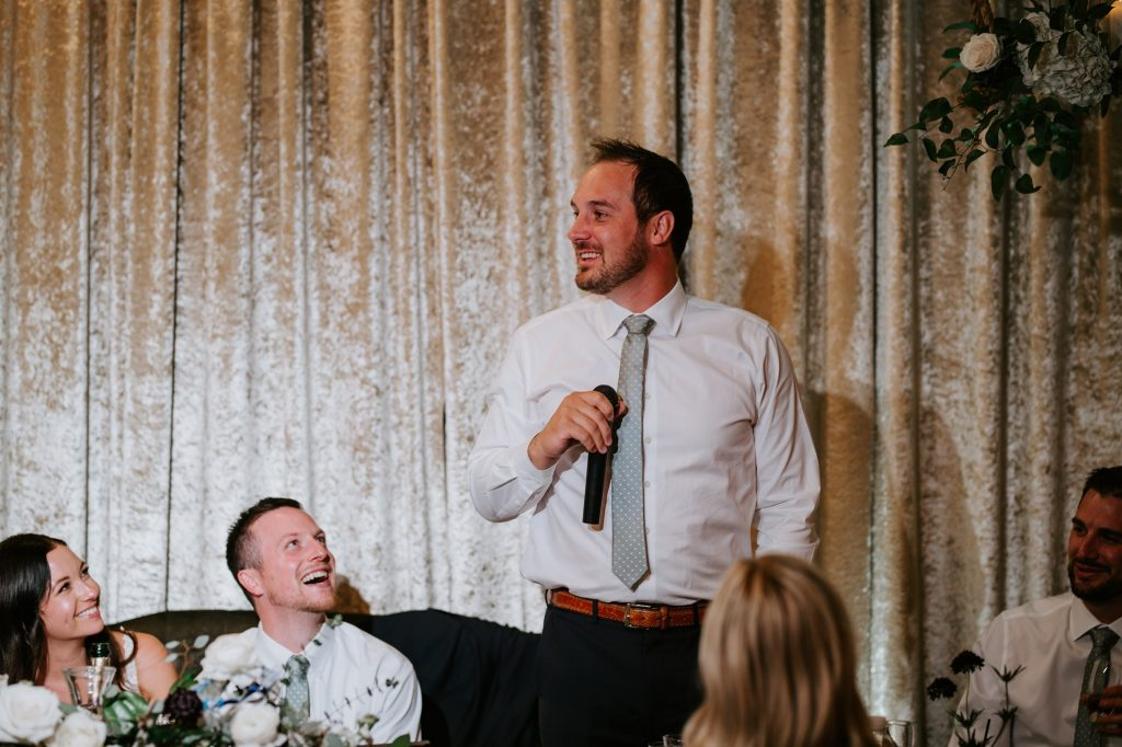 best man giving his speech during wedding ceremony