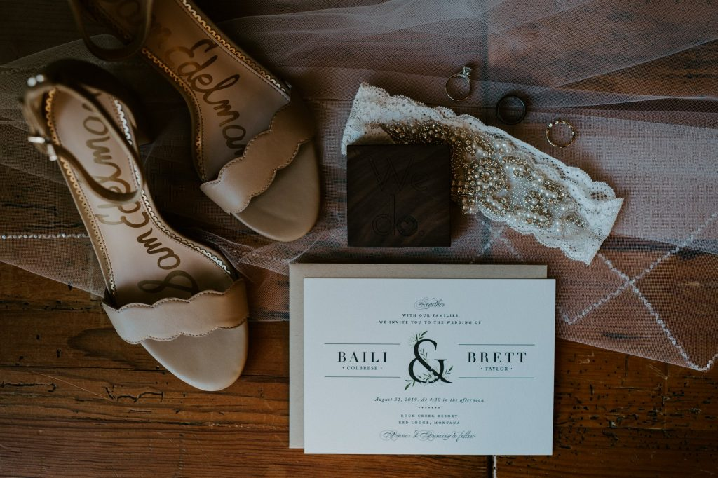 wedding shoes, rings, invitation, veil