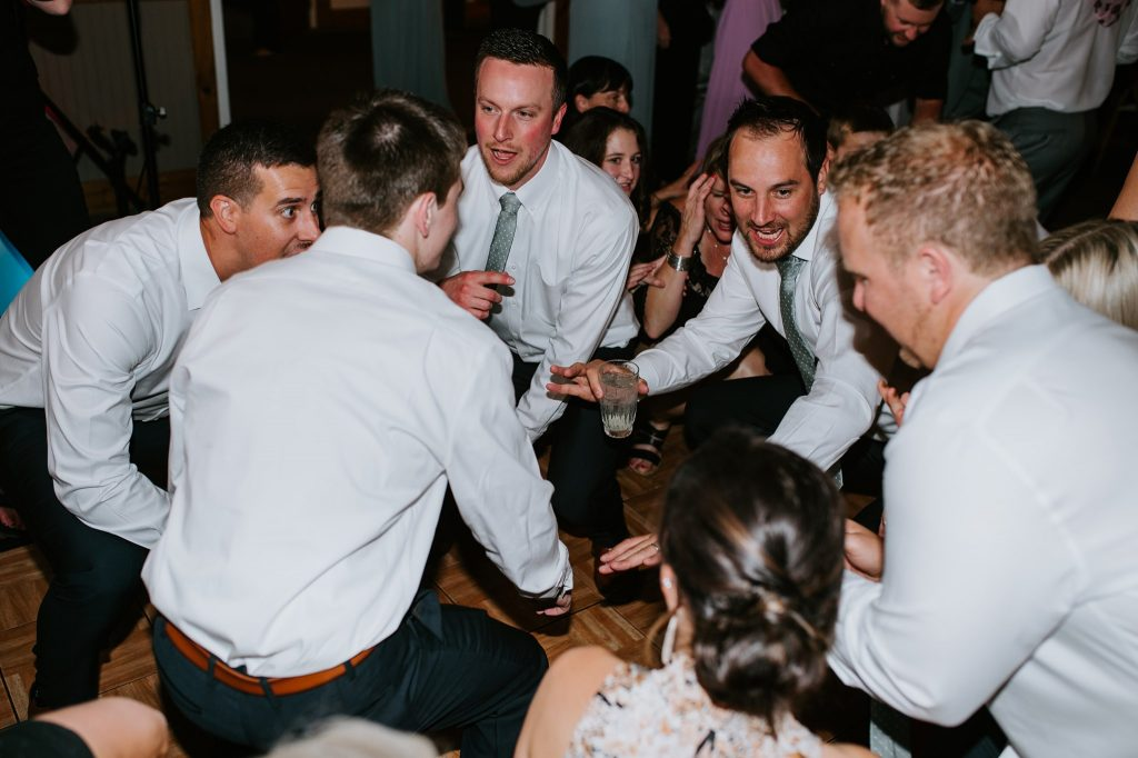 groomsmen dancing during wedding reception at Rock Creek Resort