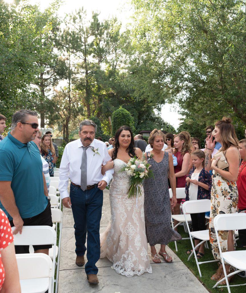 bride walking down the aisle at DanWalt Gardens