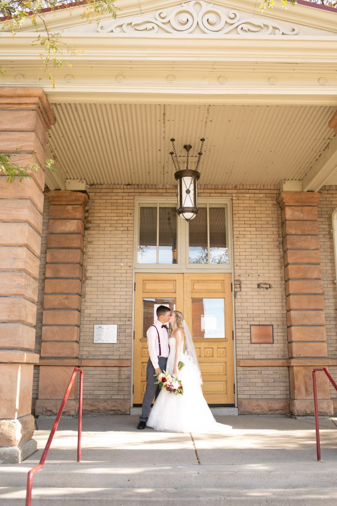 bride and groom standing outside the Billings Depot