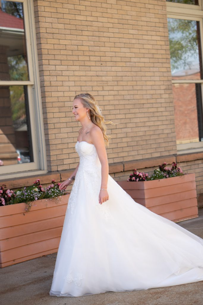bride and grooms first look outside the Billings Depot