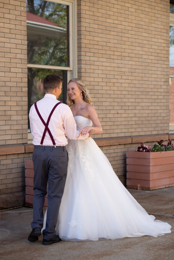 Bride and Groom first look outside of the Billings Depot