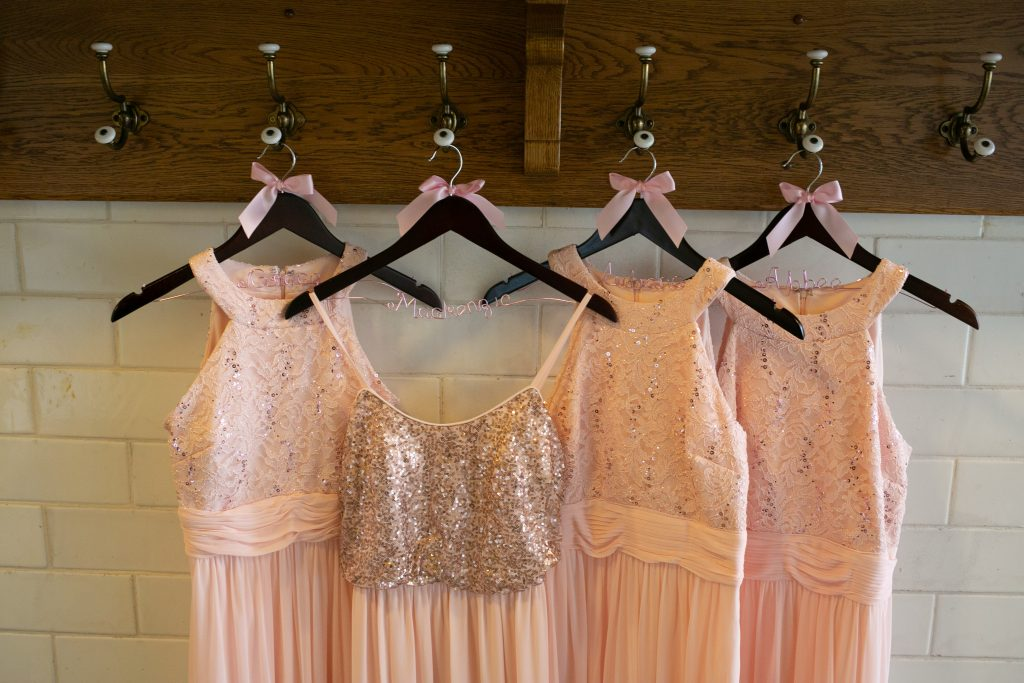 bridesmaids dresses hung up at the Billings Depot