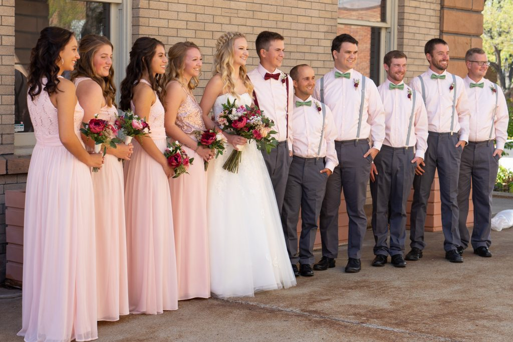 Wedding Party standing in a line outside of the Billings Depot