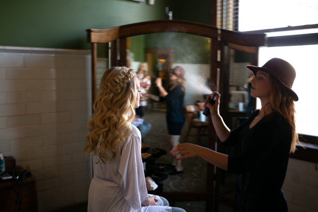 bride getting ready in the Billings Depot Bridal Room
