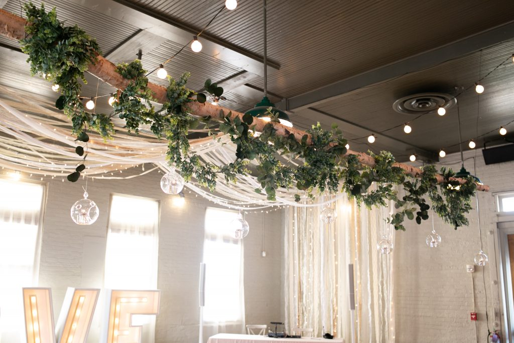 greenery and light hanging from the ceiling