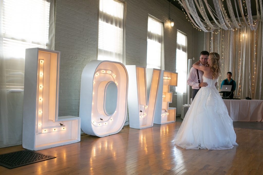 large love sign on the dance floor as the bride and groom dance