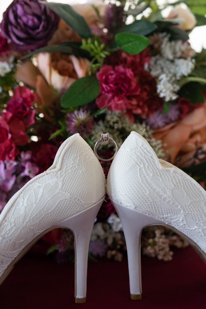 brides shoes, rings, and bouquet