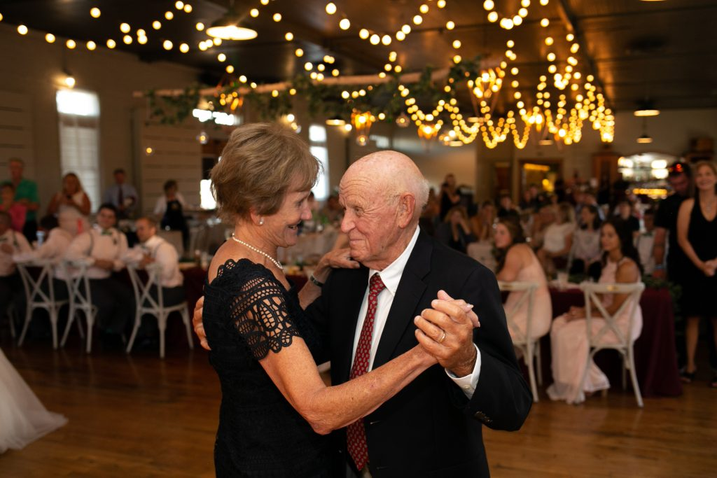grandparents dancing during wedding reception