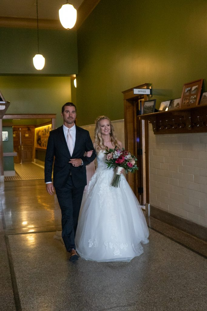 bride walking down the aisle at the Billings Depot