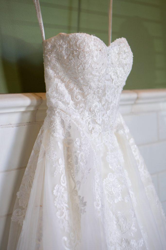 brides wedding dress hung up at the Billings Depot