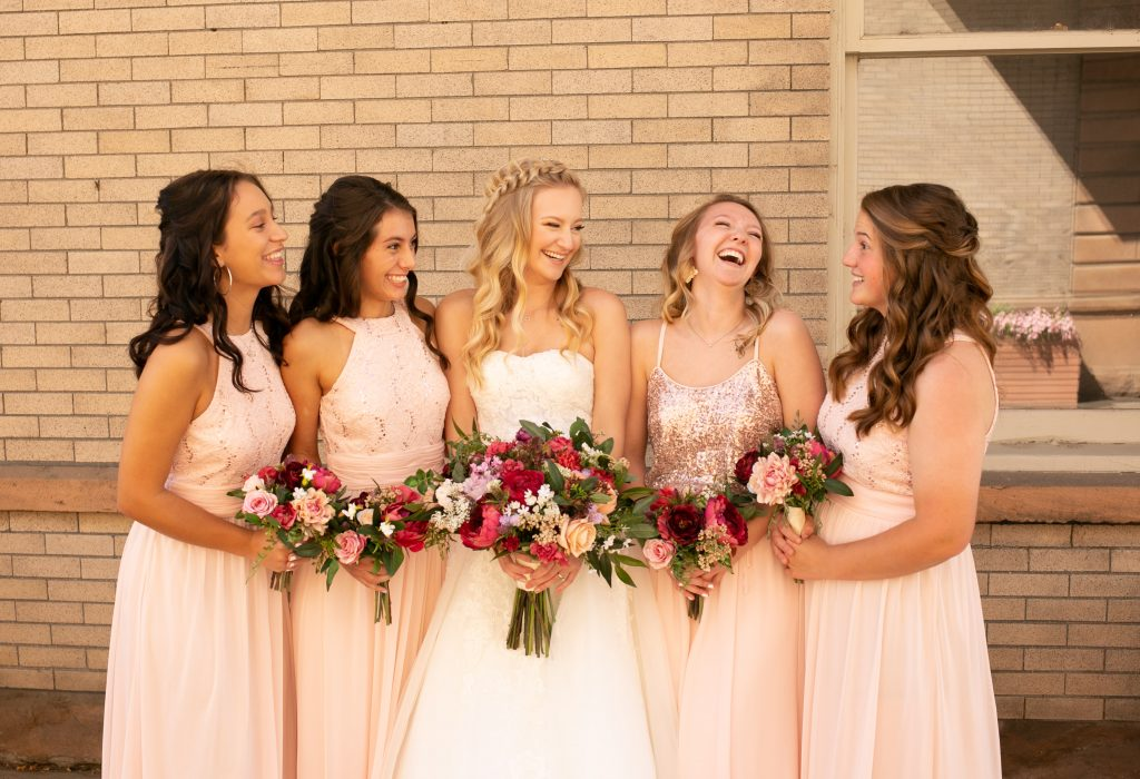 bride and bridesmaids outside of the billings depot