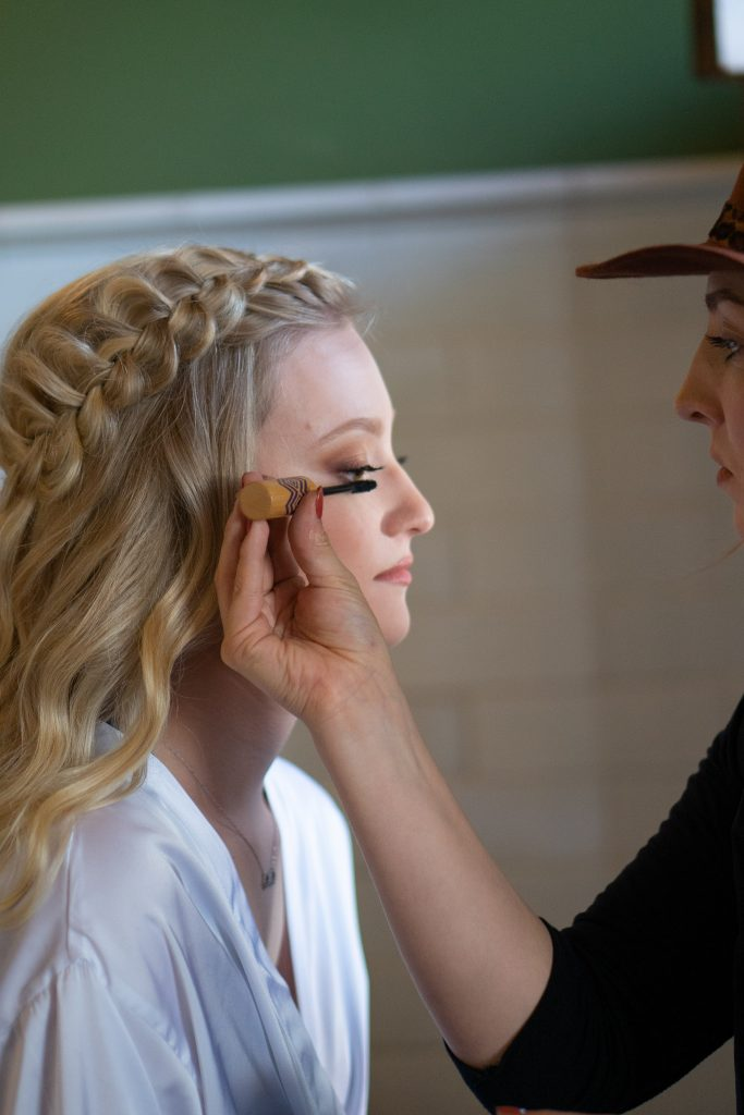 bride getting her makeup done at the Billings Depot