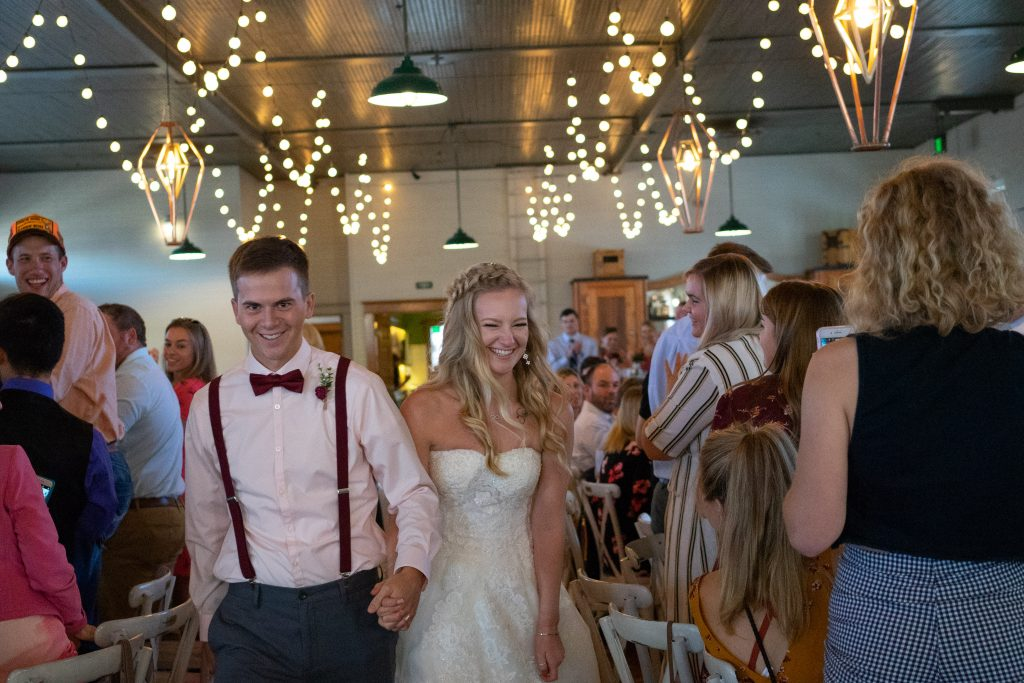bride and groom grand entrance into the Billings Depot
